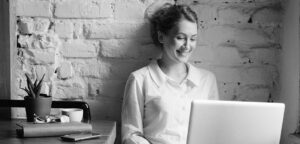 business woman looking at lap top